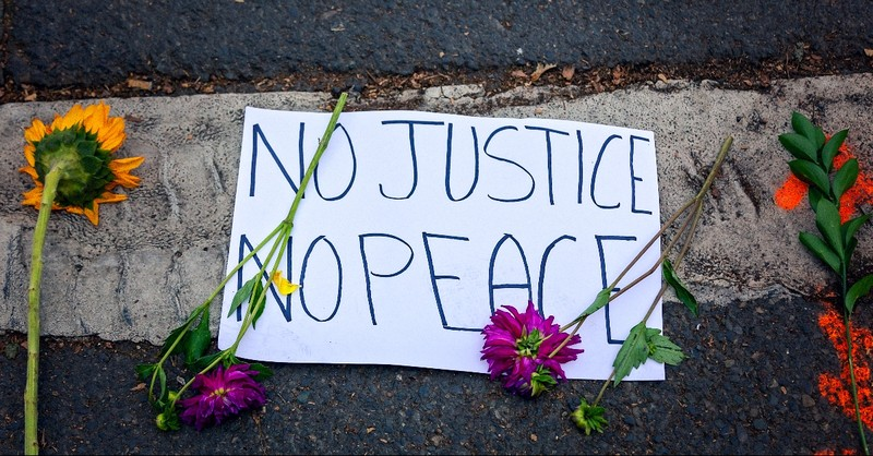 Sign that reads No Justice or No Peace