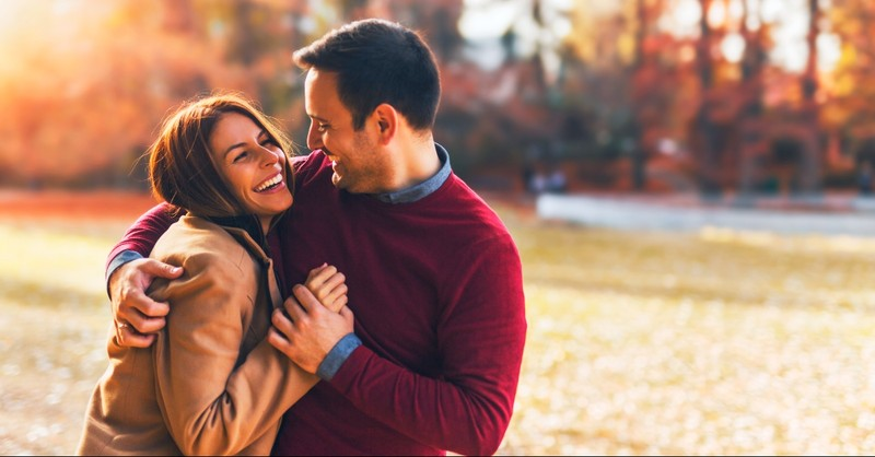 Husband and wife in a smiling embrace