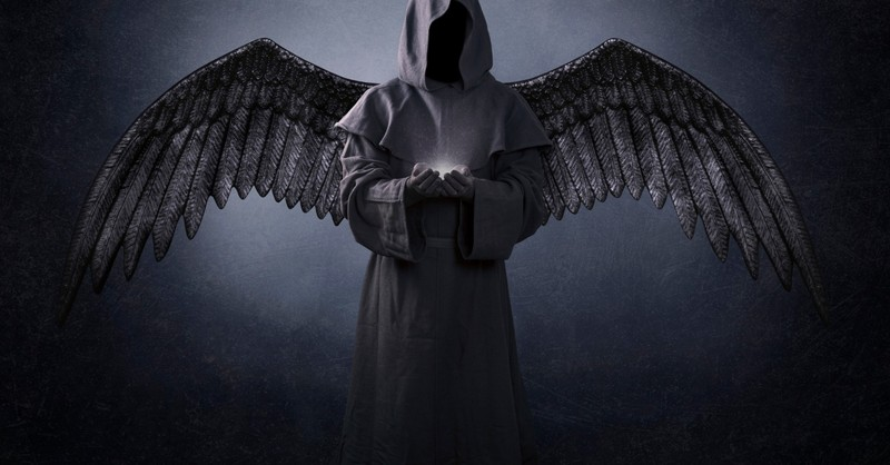 dark angel of death with light in hands