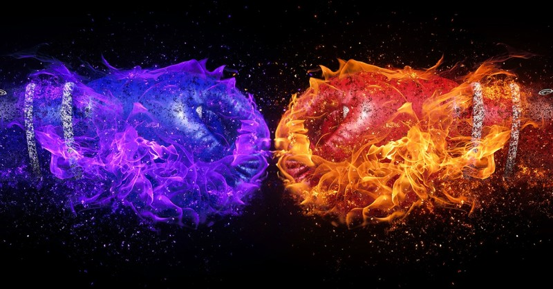 blue and red burning fists colliding to signify confrontation