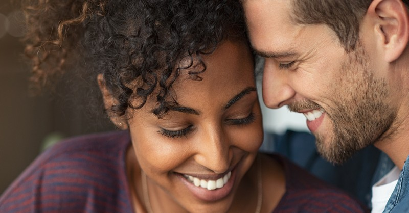 couple smiling laughing closely