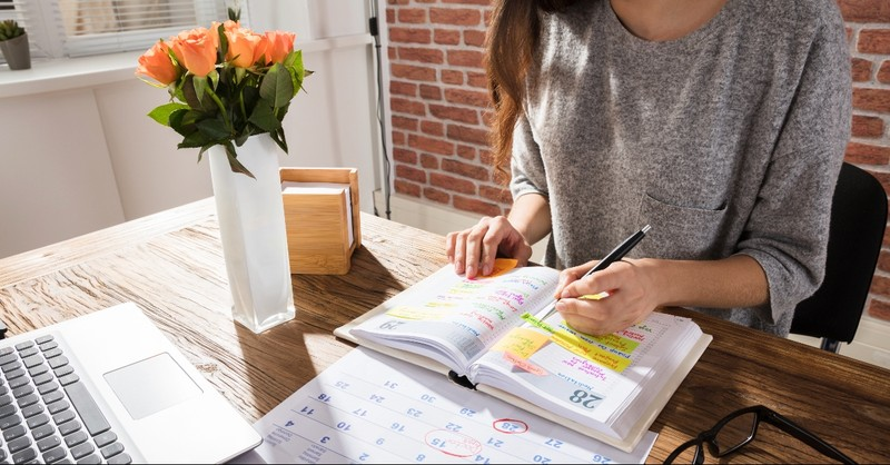 Woman making plans in day planner