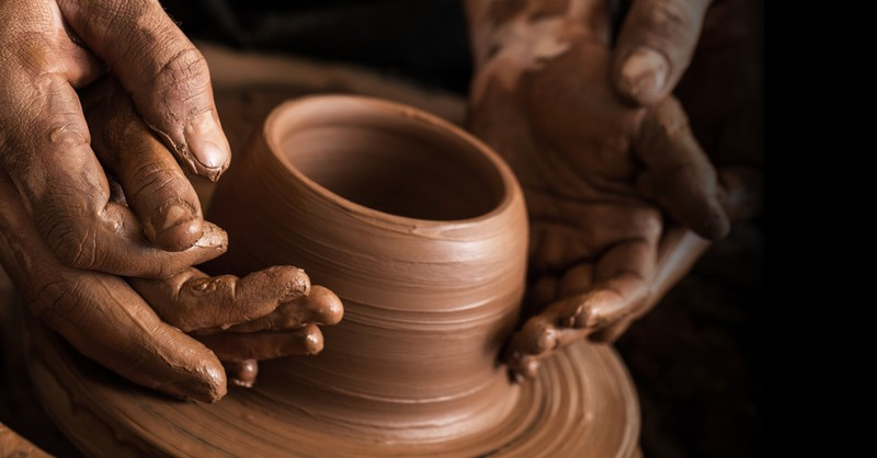 two sets hands throwing clay pot on pottery wheel