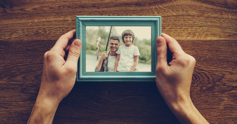 grandparent hands holding photo of son and grandson, how to handle estrangement from children