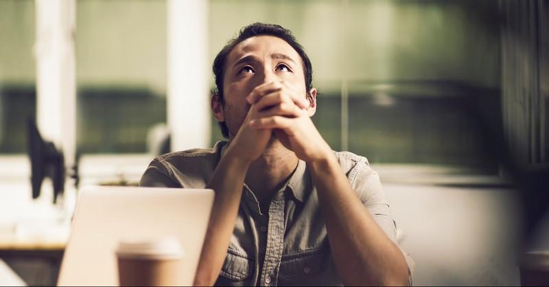 Man praying concernedly