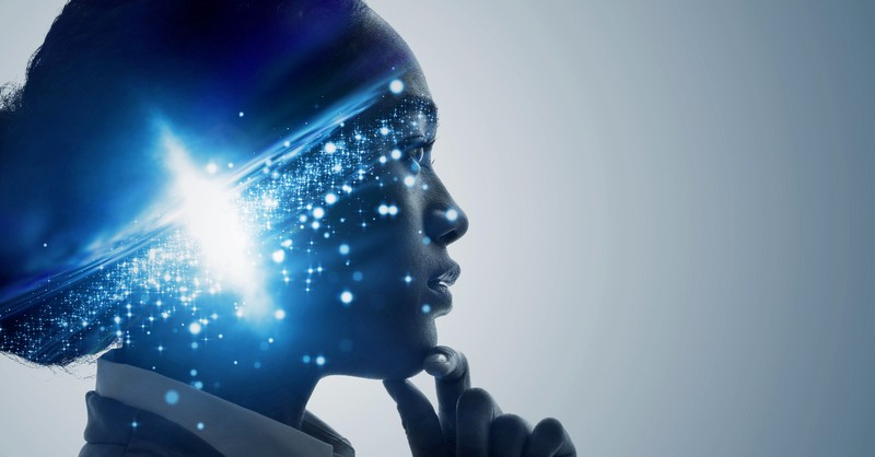 woman with lit up brainwaves - work of the holy spirit