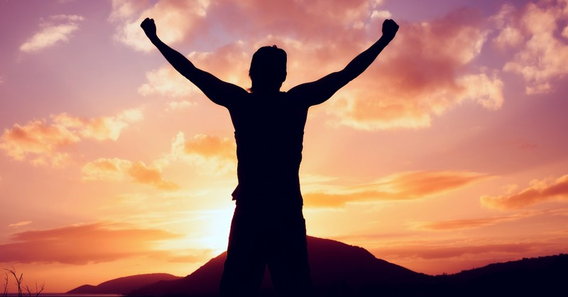 Man with arms up in victory