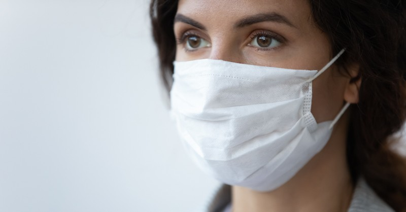 woman in face mask considering the upside of coronavirus COVID-19