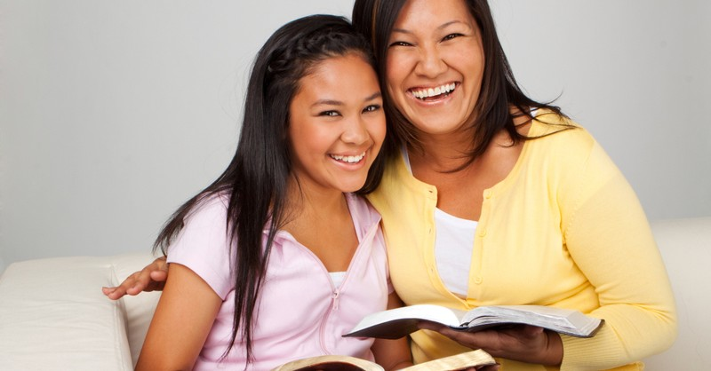 mom and daughter reading the bible