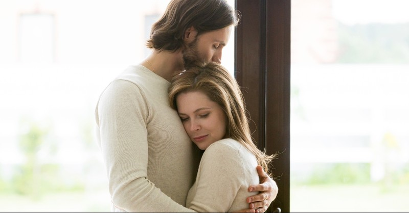 Husband wife hugging