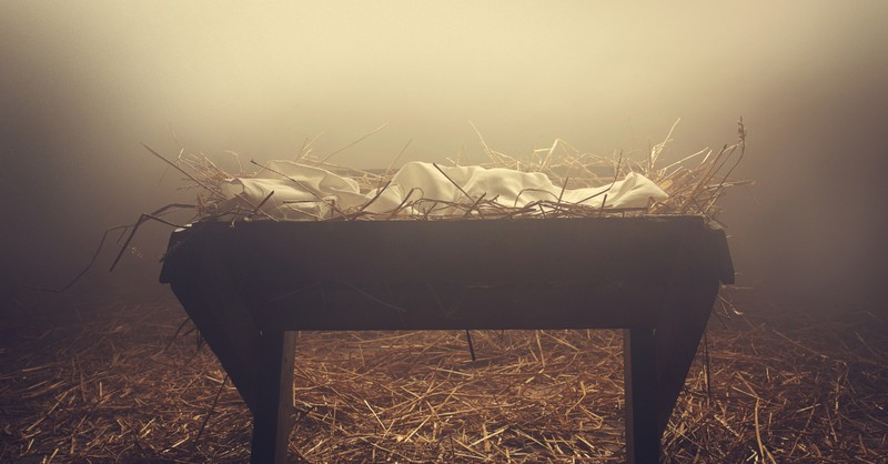 manger or creche on hay in evening fog baby Jesus Christmas