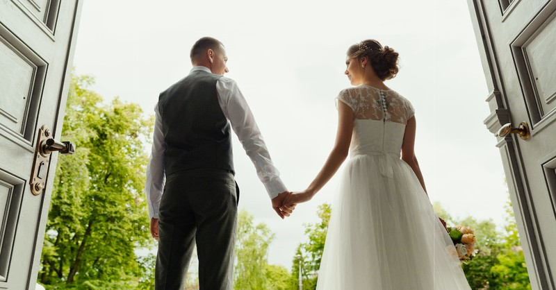 bride and groom holding hands at wedding, what is covenant marriage
