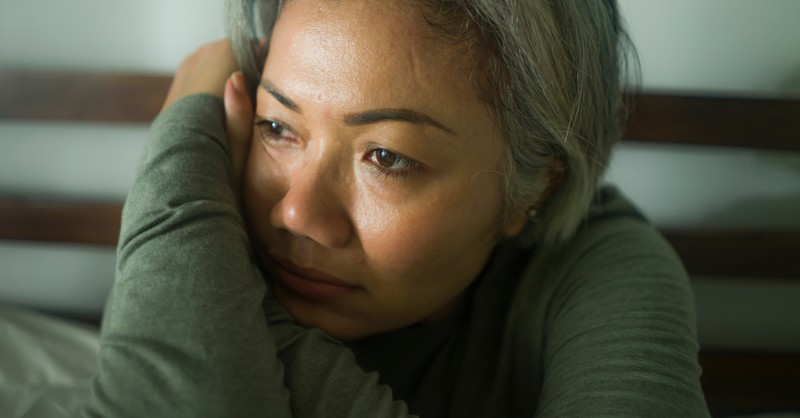 mature woman suffering wondering