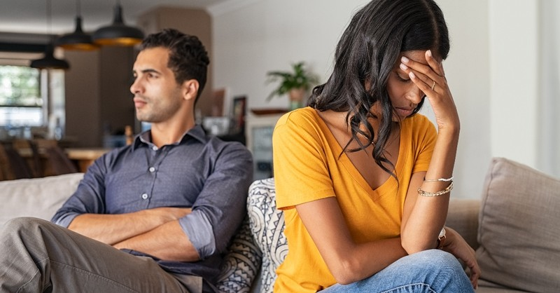wife and husband upset with each other sitting on couch, when you fear you're not enough for spouse