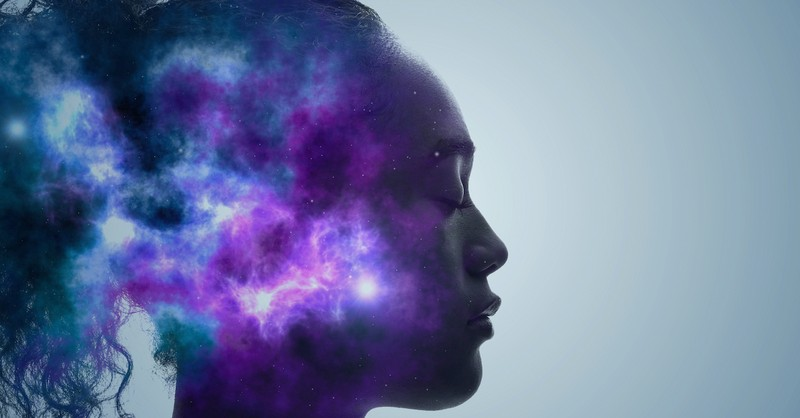 concept photo with woman's mind illuminated with purple and blue color, soul spirit difference