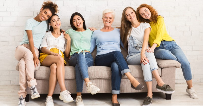 Women sitting on a couch together