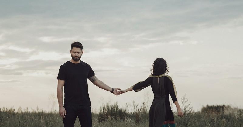 Couple in a field breaking up