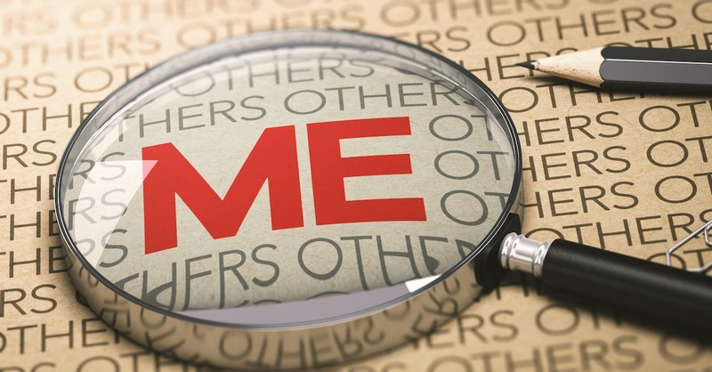 magnifying glass over the word 'me' concept of self-centeredness, warning signs of carnally minded Christians