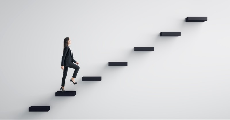 Woman climbing a series of stairs
