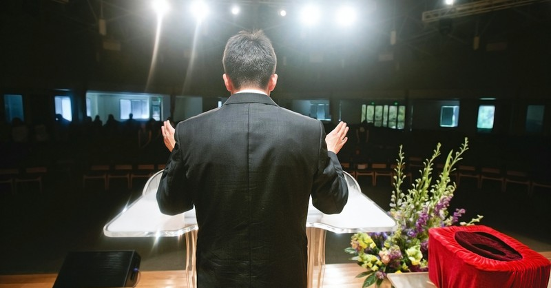 pastor in front of a pulpit, should we hold christian leaders accountable