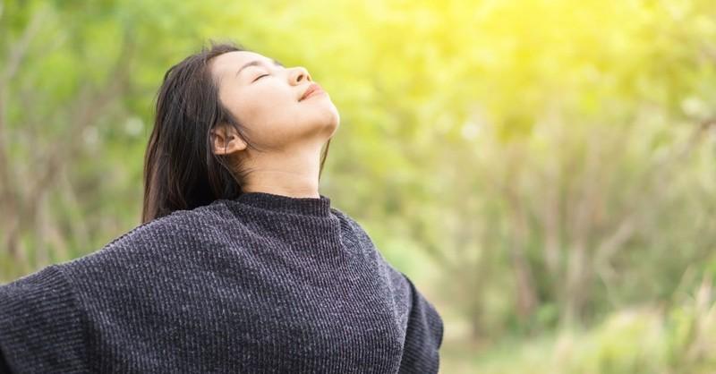 woman eyes closed facing sky