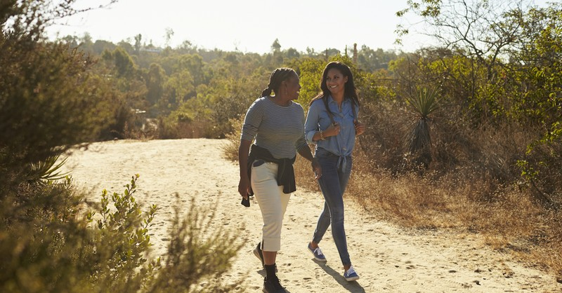 mother and daughter in law walking outside on hike