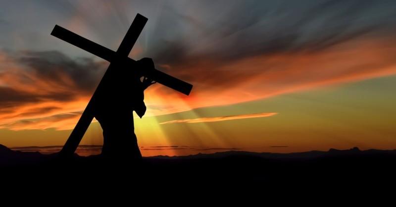 jesus carrying cross sunset
