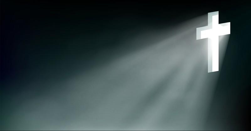 Cross shining light in the darkness
