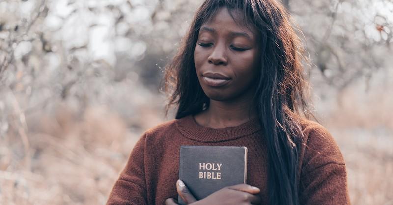 woman holding a bible praying, short prayers