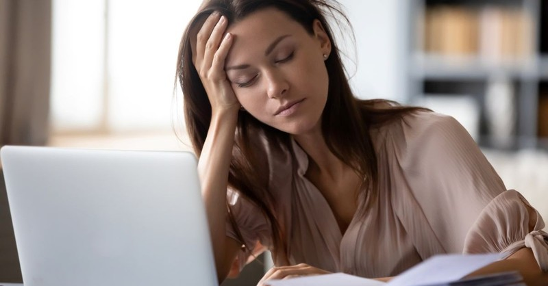 girl at computer tired burnt out exhausted overworked