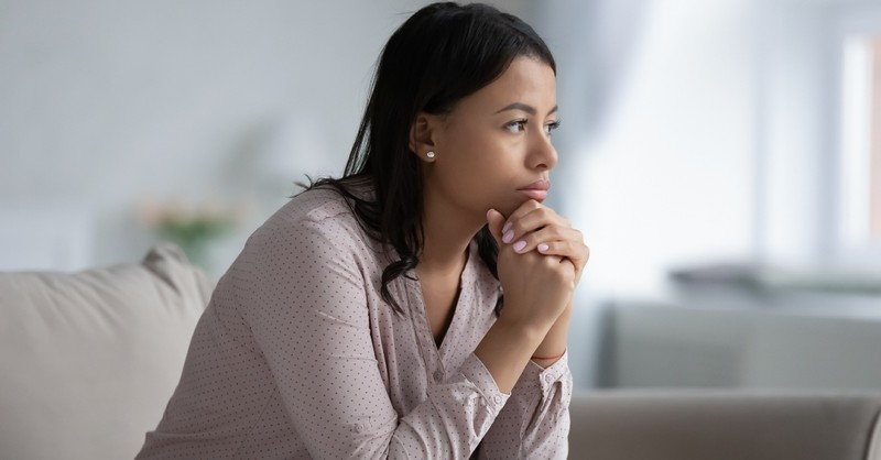 woman thinking and contemplating life, what is godly sorrow