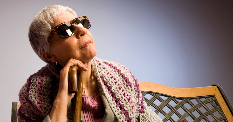 visually impaired blind woman senior sitting down