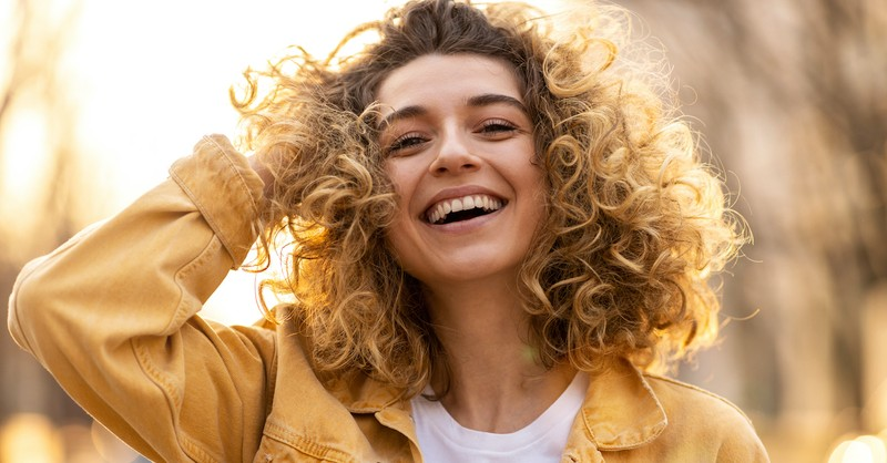 woman smiling and laughing, inspirational bible verses