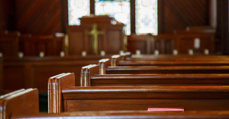 old church pews aisle podium stained glass