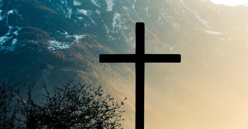 silhouette of cross in mountain landscape, abide in Christ