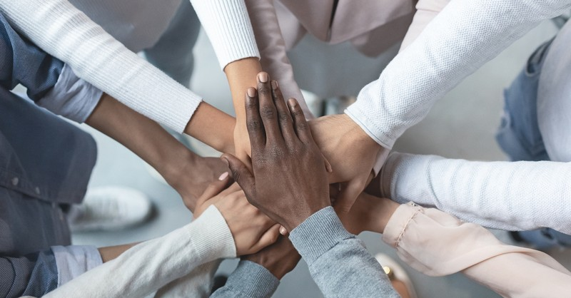 hands on top of one another to symbolize unity, John Maxwell quotes