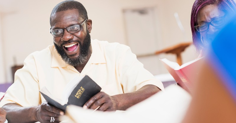 a man holding a Bible, new survey reveals that Black Americans are more religious than general American population