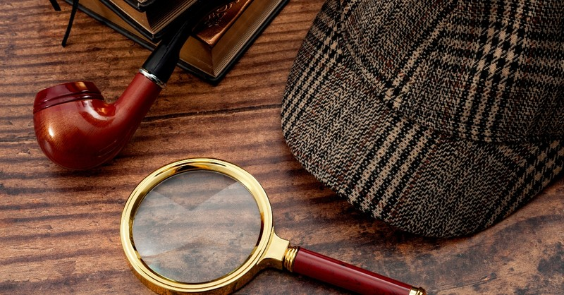 Sherlock mystery with hat, pipe, and magnifying glass
