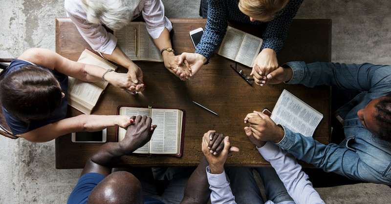 Christians praying over Bibles, bible quotes on faith