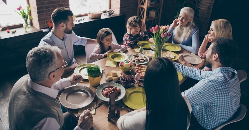family sitting around an easter, easter dinner prayers