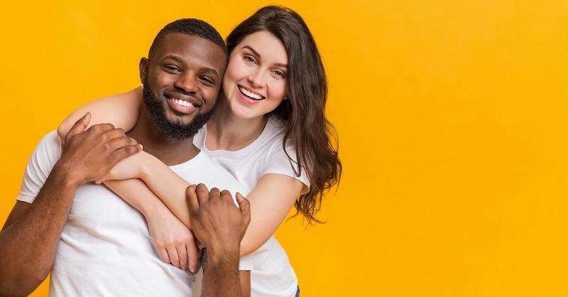 a couple embracing, interracial marriage