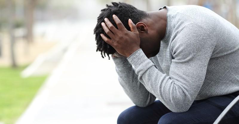 Man who's hurt praying