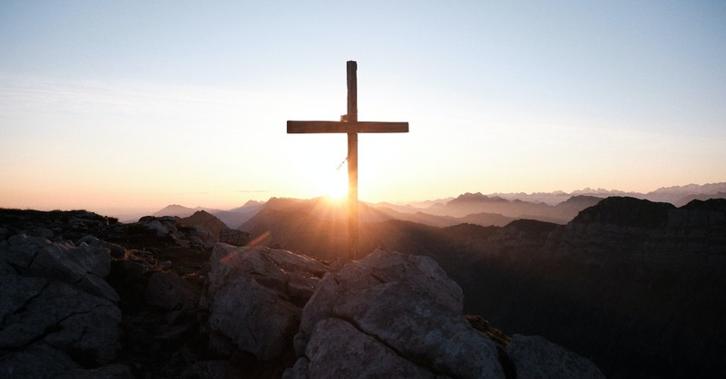 cross on top of mountain with sunrise, yannick-pulver-unsplash