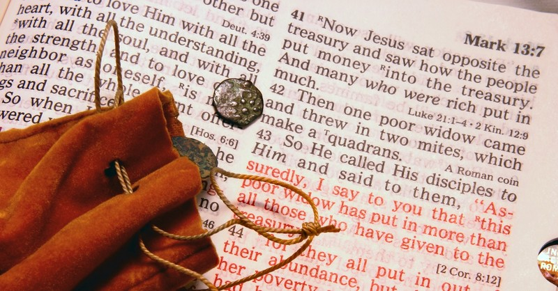 widow's mite small coins resting on top of Mark Bible passage