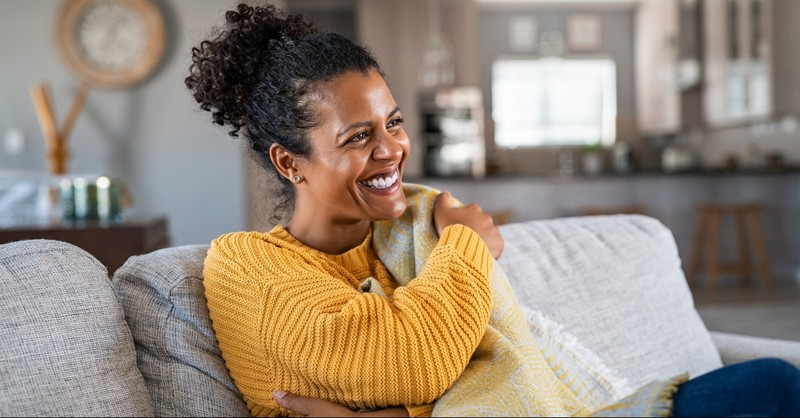 Woman smiling on her couch
