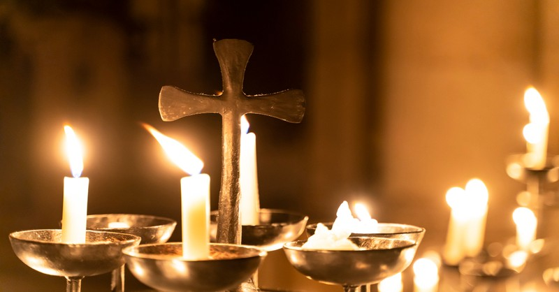 cross and prayer candles