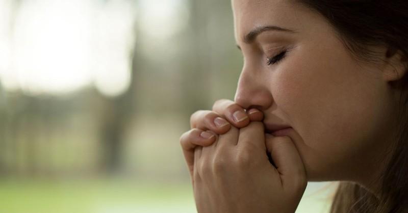 woman praying prayer sad tears crying upset mourning