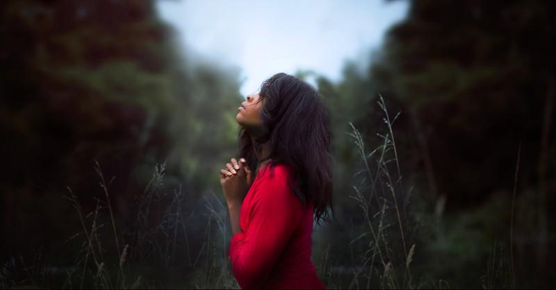 Woman intentionally praying