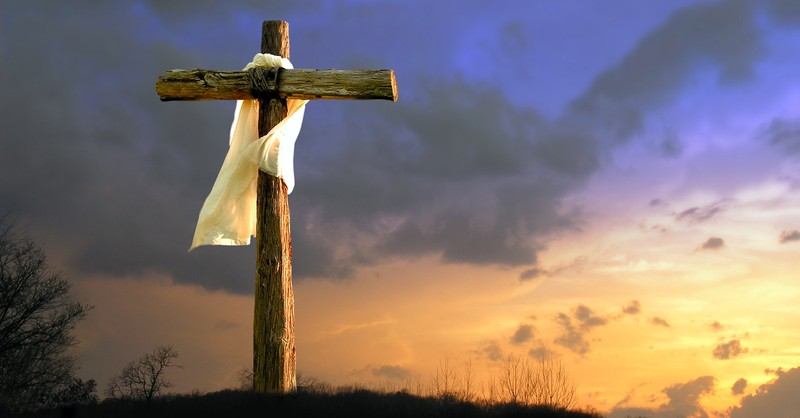 Cross with white cloth in the sunset