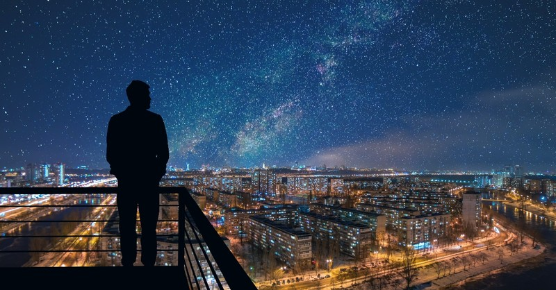 Man looking over a starscape